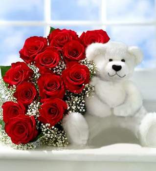Bouquet of red roses and Teddy bear